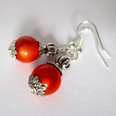 ORANGE...Tibetan Style 3D Illusion Earrings (£4.00)  To order, message me on Facebook (click 'Message' at the top of the Genuine Red Facebook Page) or e-mail thegenuinered@gmail.com
