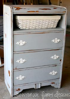 Refinished dresser - shelf replacing a missing drawer, distressed grey paint, brass pulls redone with ivory
