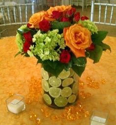 BloomNation (Pictured is the LIME VASE - Lime filled vase, with orange roses, hot pink rose sprays green hydrangea, $100.00).  BloomNation lets you shop directly with the florist creating your arrangement. With over 45,000 unique and one-of-a-kind arrangements from more than 2,500 top local artisan florists.