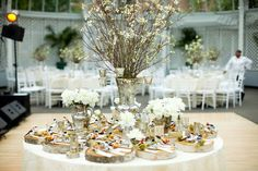 winter wedding bar branch and babysbreath centerpieces