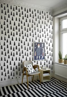 Spruce Wallpaper by Fine Little Day in Sweden must be mine. A steal for $34 a roll. A little forest of black trees on my wall. What could be better?