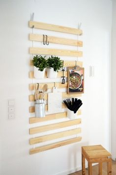 REPURPOSE BED SLATS AS A WALL HANGER – This $10 IKEA hack really thinks outside the bed box. The SULTAN LADE usually hides under the mattress, but the wooden planks can hold magazines, kitchen herbs and even shoes when hung vertically. Click through for the entire gallery and for more storage solutions.