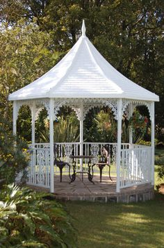 I want a gazebo with stained glass windows hanging in each arch or opening