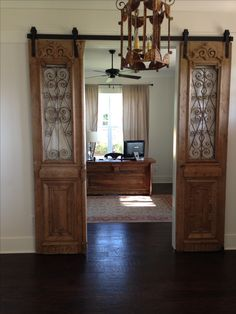 "Our antique French iron exterior doors hung ""barn door"" style and our custom…"