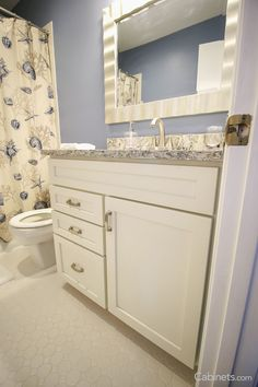 Alabaster Colored Shaker Style Cabinets Look Clean And Serene In This  Seaside Bathroom.