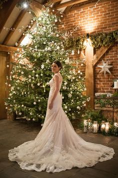 The dress, The Christmas tree, the light !! The most beautiful Christmas Winter wedding - wowzers. The perfect venue for a winter wedding in a heated barn.  Copyright Kerry Ann Duffy Photography