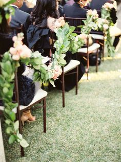Floral Garlands draped on the ceremony chairs. Ruffled – photo by http://www.erichmcvey.com/ – http://ruffledblog.com/sierra-madre-wedding/