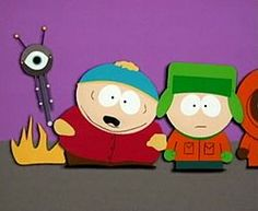 A crudely animated cartoon image of an obese child with a red jacket, brown pants, black shoes and a blue hat. Flames appear from the rear of his body, as well as a tall vertically shaped machine with a single eye and two antannae. Standing next to the boy is another boy wearing an orange jacket, green pants, brown shoes, a green hat and gloves.