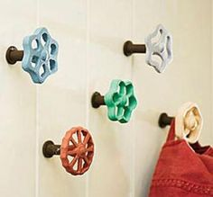 Old water facet knobs...  paint them and viola! Colorful pleasing wall hangers.