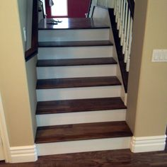 Love wood tread with finished rise. Use Acacia wood for the treads and paint the risers white.
