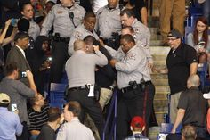 PDONALD TRUMP RALLY VIOLENCE  - March 11, 2016 -  A bloodied man is escorted from a Donald Trump rally by St. Louis police hotos & Video:  49 days ago: