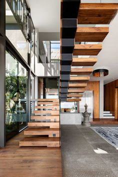 Top 10 Unique Modern Staircase Design Ideas for Your Dream House Modern Staircase Design Ideas – Stairways are so common that you don't give them a doubt. Look into best 10 examples of modern staircase that are as magnificent as they are … Wooden Staircase Design, Home Stairs Design, Floating Staircase, Wooden Staircases, House Design, Stair Design, Railing Design, Stair Handrail, Staircase Railings