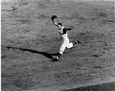 Second baseman Bill Mazeroski at the plate. Description from obitoftheday.com. I searched for this on bing.com/images