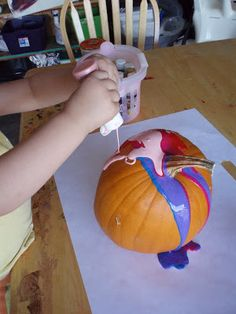 Squeeze paint on pumpkin