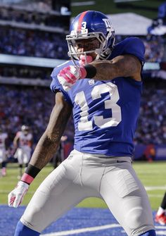 9270f674a Falcons - New York Giants wide receiver Odell Beckham celebrates after  scoring on a touchdown pass from quarterback Eli Manning during the second  half of an ...
