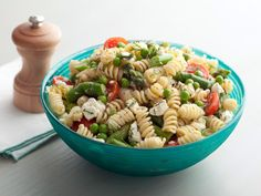 Neelys' Lemon Pasta Salad : Pack the pasta, vegetables and dressing in separate containers, take them on the road, then dress the salad once you're ready to serve.