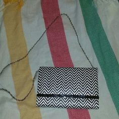 Zig zag chevron clutch New with tags Forever 21 bag! Detachable chain strap can be used as clutch. 9 inches wide 9.5 inches tall. Button closure one inside pocket. Great staple for everyone! Forever 21 Bags Clutches & Wristlets