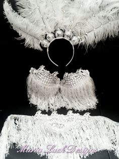 PLUS SIZE Sexy white Vegas Showgirl costume with  ostrich feather & disco ball headpiece. $149.99, via Etsy.