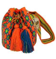 Single thread Putchipuu bucket bag, hand crocheted by the women of the Wayuu people in northeast of Colombia. Taking roughly 5 weeks to be completed. - Draw String Closure - Wide cross-body strap Mate