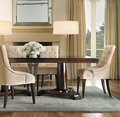 Martine Upholstered Armchair and Portman Dining Table from Restoration Hardware. I also love the pendants!