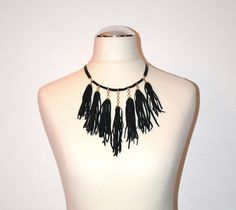Black leather necklace with golden chains and tassels