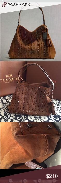COACH 37161 Saddle Suede all over studs Style 37161 - Effortless, top-selling Edie gets a new downtown edge in luxe, velvety suede with dramatic rows of pointed studs and industrial grommets. This ultra-functional design keeps essentials elegantly organized within its three-compartment interior. Inside zip, cell phone and multifunction pockets  Zip-top closure, fabric lining  Style No: 37161 - Ships with original box, COACH bag, and protective fabric bag and tissue paper/ribbon wrap. Coach…