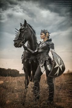 Woman warrior with black warhorse and armor. MEDIEVAL ⚔Woman warrior with black warhorse and armor. MEDIEVAL ⚔Woman warrior with black warhorse and armor. Warrior Princess, Warrior Girl, Warrior Women, Goddess Warrior, Fantasy Warrior, Fantasy Characters, Female Characters, Horse Costumes, Fantasy Photography