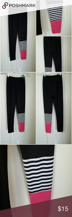 Girls Medium Black Leggings with Design on One Leg Girls medium black leggings. Pink and black and white stripes on one leg at the bottom. Super cute! Pre-owned and in good condition. 95% Polyester 5% Spandex Bottoms Leggings