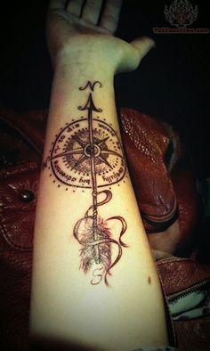 love the arrow incorporated in the compass...but only on my leg