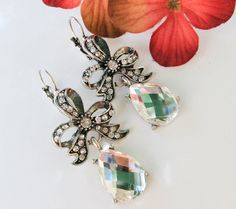 A personal favorite from my Etsy shop https://www.etsy.com/listing/105838287/new-vintage-rhinestone-bow-teardrop