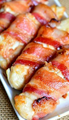 Bacon Wrapped Chicken Strips: Juicy chicken tenders glazed with a combination of maple syrup and Dijon mustard and wrapped in thick applewood bacon. ((I would like to try cooking the chicken in ranch seasoning instead and then wrapping with bacon)) Think Food, I Love Food, Good Food, Yummy Food, Tapas, Bacon Wrapped Chicken, Chicken Bacon, Grilled Chicken, Tyson Chicken