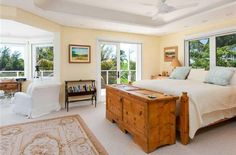 Olivia Newton-John | Tucked away on Florida's Jupiter Island, Newton-John's bedroom includes its own bar, sitting area, deck, and a built-in pop-up television. | #celebshome #celebritymansions #celebrityrealestate | See also: http://www.celebrityhomes.eu/