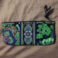 Vera Bradley Small Pencil / Cosmetic Case Authentic Vera Bradley blue and green floral pattern small case. Great for either makeup brushes, lip glosses, etc. or as a pencil case. Comes with lining, which does have a little mark on it as pictured. Measurements are 8.75 inches by 4 inches Vera Bradley Bags Cosmetic Bags & Cases