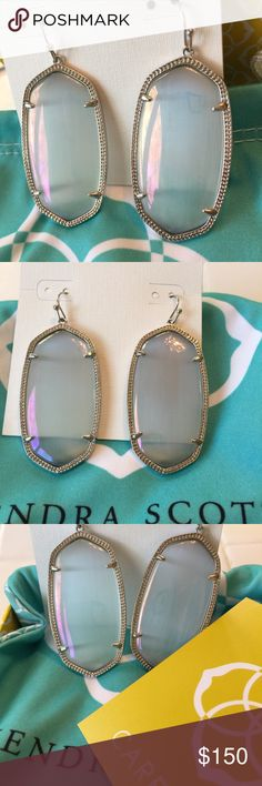 NWT Kendra Scott Danielle's Iridescent & Rhodium These are super rare! Brand new with tags slate iridescent Kendra Scott Danielle earrings in rhodium (silver). The staff at the KS store said very few were set in silver and these are a collector's item. Comes with KS signature blue dustbag. Please no lowballs or trades Kendra Scott Jewelry Earrings