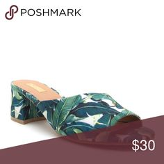 "🌿 Green & White island print must have mule 🌿 This island print must have mule has a low 1.5"" heel; the perfect height for a casual vacation shoe or a brunch out with the ladies.  The thick single strap is not your basic, rectangular strap.  It has a ""flare"" that has a unique design and coverage.  The colors are multi greens against a white background. All materials are 💯 percent vegan and these Island mule slides fit true to size Qupid Shoes Sandals"