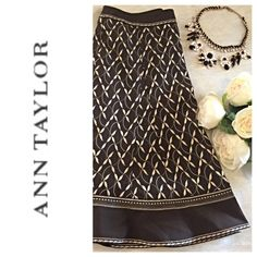 Gorgeous Skirt Sz 2P Stunning Chocolate Brown Skirt with gold stitching. So pretty and perfectly on trend. Poly/rayon/spandex blend. Unworn and in flawless condition. From a pet and smoke free home. Ann Taylor Skirts