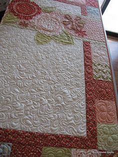 Longarm quilting by Ann at the BunkHouse. Love how she quilted larger paisleys as she worked down the quilt.