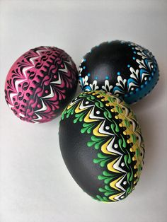 This is a set of three chicken eggs dyed in yellow, blue, magenta and black and decorated with colored wax. To create the eggs, I use the pinhead method, likewise known as the drop-and-pull technique. In this method, mostly used in Poland, the Czech Republic, Slovenia, and Lithuania, a pin
