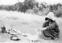 Woman cooking over a campfire. Western History Collections, University of Oklahoma Libraries, Irwin Brothers Studio Collection, Early Scenes