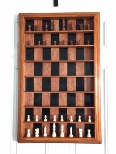 """Love chess, but hate having to stop in the middle of a game when you don't have time to finish? This DIY vertical chess set made by Redditor pigthunder will ensure you never have to abandon a game again. It hangs on the wall, so you can pick up where you left off anytime. Here's how to make your own. What You'll Need 16 thin pieces of wood, cut into 16"""" lengths (the width depends on how tall you want the finished product to be; red oak was used in the original) 4 pieces of crown molding, for…"""