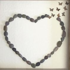 This particular listing is for an 8x8 inch pebble picture design of a heart created in pebbles and with coordinating butterflies, framed in a distressed rustic wood frame, mounted on textured ivory backing card, ready to hang on a wall or lean on an easel. This is an ideal Wedding