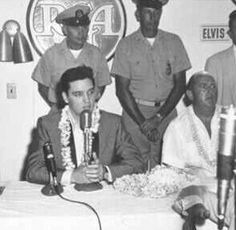 Elvis and Colonel Parker at the THE PRESS CONFERENCE for the Benefit Concert ~ USS Arizona Memorial, was held in the Carousel room at the Hawaii Village Hotel, Honolulu, Hawaii, March 25, 1961
