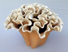 Reminds me of a wild mushroom, cool organic looking piece.