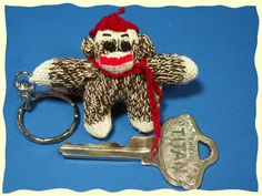 Teeny tiny sock monkey, get in my pocket! I must have one! I just must!