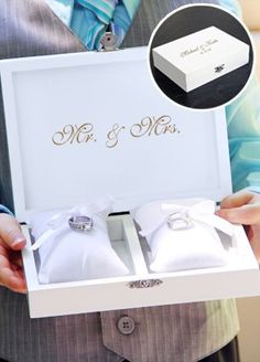 For the bride looking to combine personalized style and contemporary charm to her big day, our Ring Bearer Pillow Boxes make ideal ceremony alternatives. Set includes personalized box, two velvet ring pillows, featuring satin ties for secure ring placement as well as two velvet lined jewelry inserts for transitioning into a keepsake jewelry box post ceremony.  Features and Facts:  Dimensions: Measures 7.5 in. W x 5.5 in. H x 2 in. D  Comes complete with two ring pillows featuring satin ties…