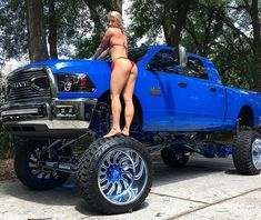 Almost missed the hottie on the tire cause this truck is fire! Cummins Lifted Dodge Ram
