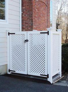This trash enclosure, by West Hartford Fence, hides large trash and recycling bins behind sedate lattice doors. by West Hartford Fence Co., LLC (ours is going to be built around our pool equipment to camouflage it) kj Trash Can Storage Outdoor, Garbage Can Storage, Outdoor Trash Cans, Storage Bins, Garbage Can Shed, Patio Storage, Hide Trash Cans, Trash And Recycling Bin, Trash Bins