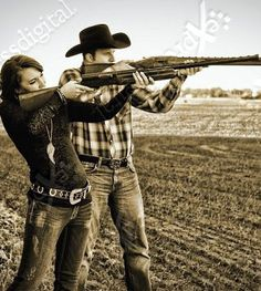 Cute wedding picture, except I'd wanna do it with bows instead of guns because if you know me, you know that archery is something I love.