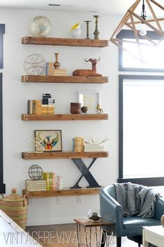 I love floating shelves ::: DIY Built In Shelving Living Room Makeover @ Vintage Revivals