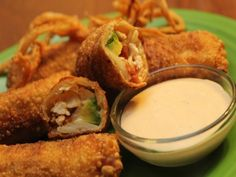 An eggroll with creamy avocado, crisp bacon, garlicky grilled chicken and melted cheese. Be sure to prepare these in the exact order written, to prevent the wrappers from becoming soggy. You can use your favorite ranch dressing to make the Ranchito Sauce for dipping. From the California Pizza Kitchen Family Cookbook